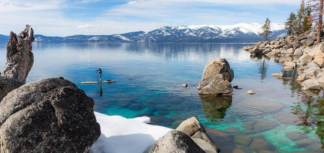 Paddle board on Tahoe with snow.